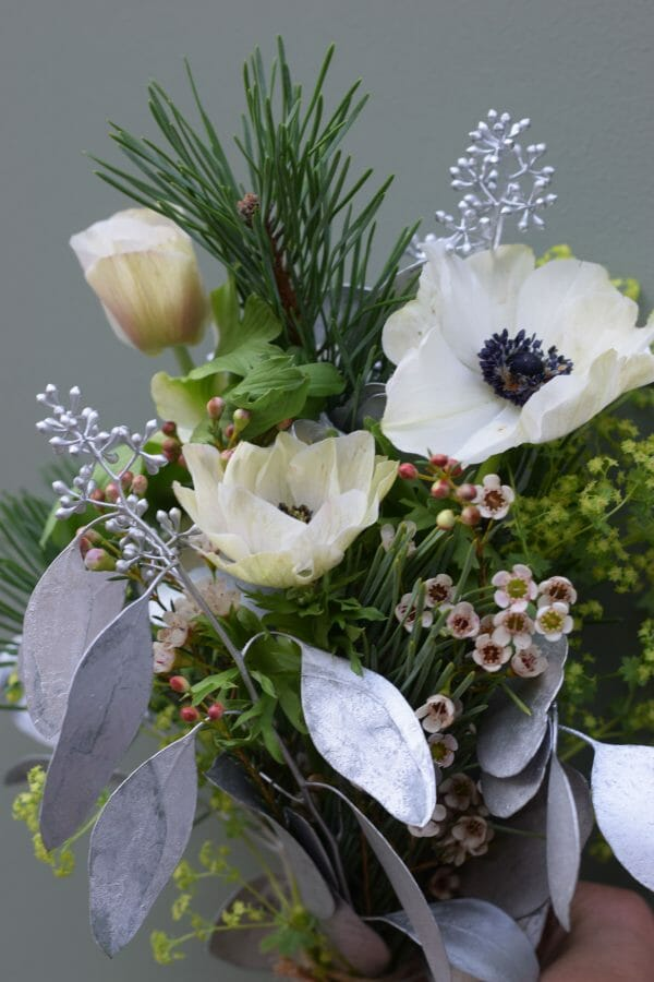 Christmas flowers of seasonal greens and whites available from Kensington Flowers London