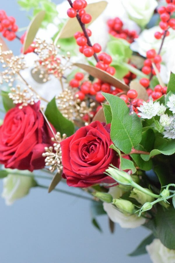 Christmas bouquet of seasonal reds, greens and whites available from Kensington Flowers London
