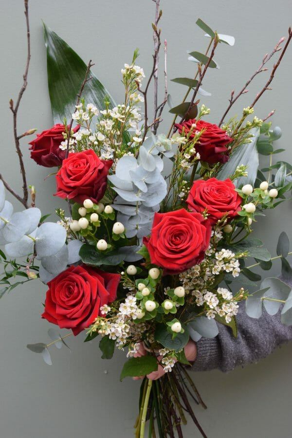Photo showing a sample of a red rose bouquet of 6 stems, available from Kensington flowers London
