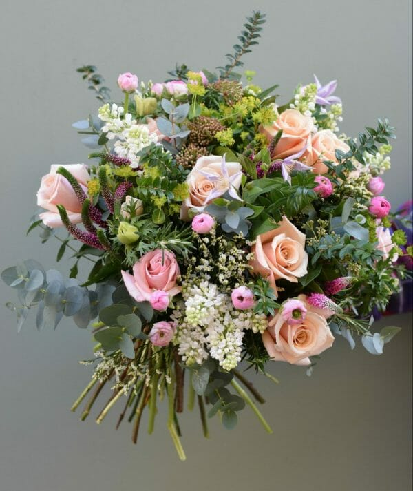 photo showing a sample of a Seasonal rose bouquet of mix pastel colours available from Kensington flowers London