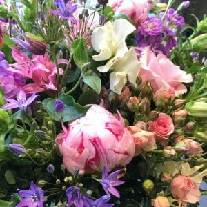 Sweet peas peonies spray roses nerines pink flowers purple flowers summer floral arrangement bunch Kensington delivery