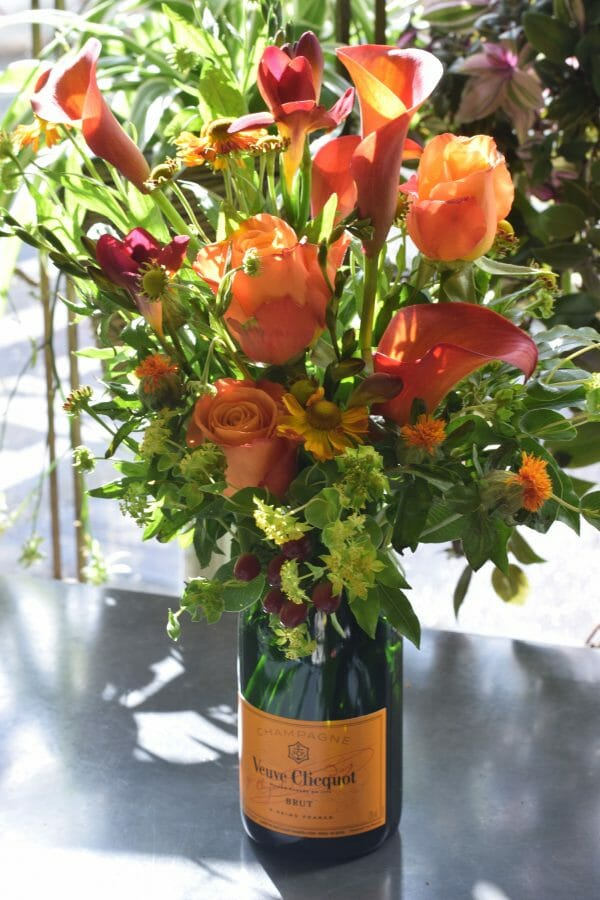 Photo showing a sample of a Champagne flower-bottle 75cl Brut available from Kensington flowers London