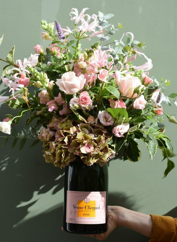 Photo showing a sample image of a Rose Magnum champagne flower bottle available from Kensington Flowers London