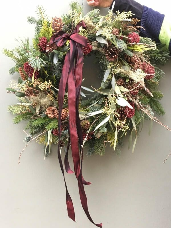Photo showing a sample of a Mixed pines and foliages, with lichen and cones Kensington flowers London Christmas door wreath