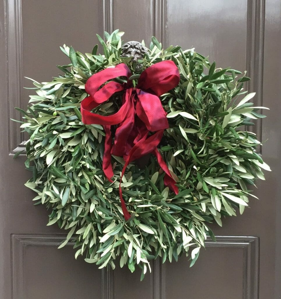 Photo showing a sample of an Olive Christmas Door Wreath Kensington flowers London