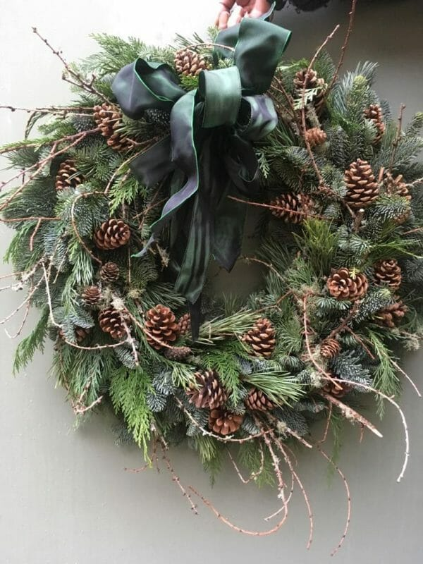 Photo showing a sample of a Rustic mix foliage Christmas door wreath