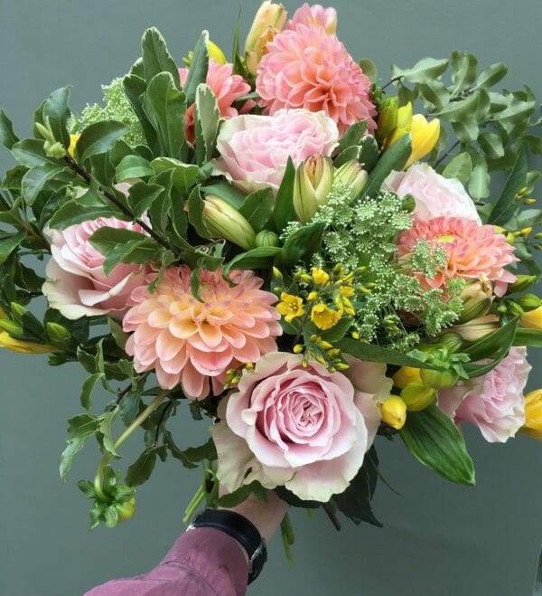 Photo showing a sample of a Seasonal hand tied bouquet Pastel shades Kensington flowers London
