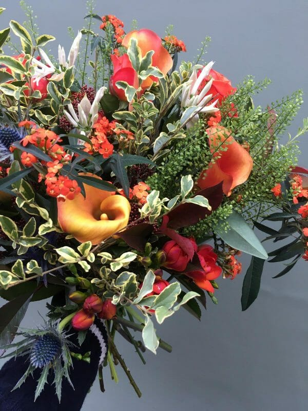 Photo showing a sample off a Seasonal handtied bouquet Oranges and whites Kensington flowers London