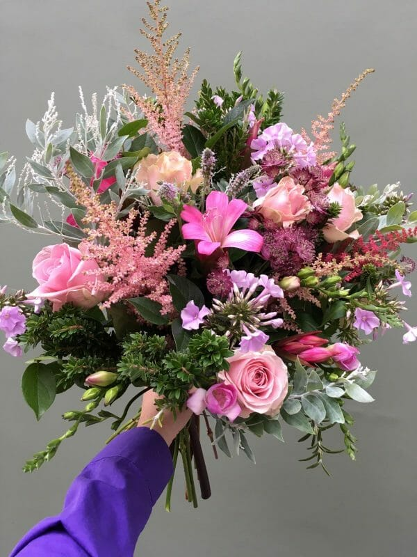 Photo showing a sample of a Seasonal hand tied bouquet pink shades Kensington flowers London