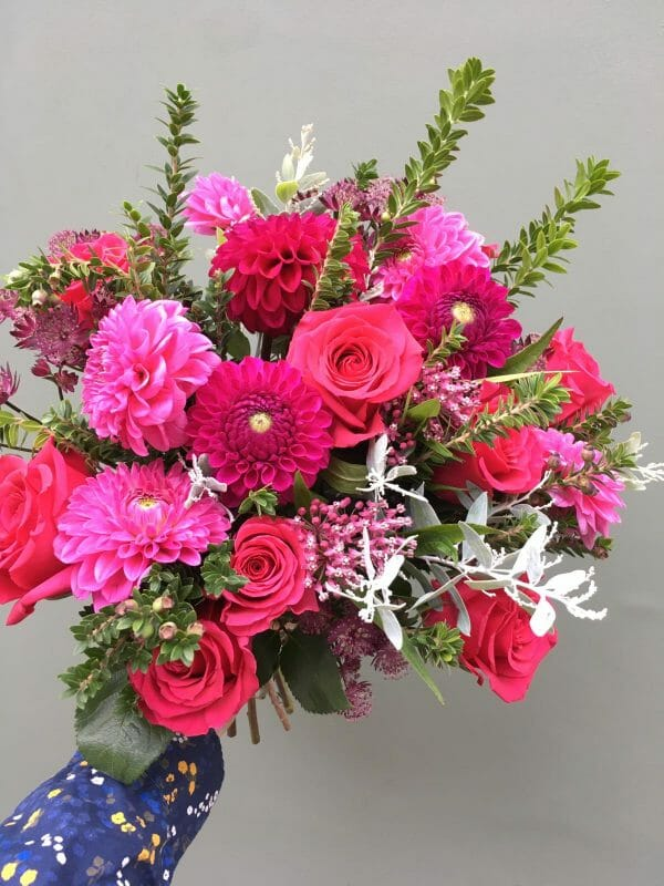 Photo showing a sample of a Seasonal handtied bouquet vivid Kensington Flowers London