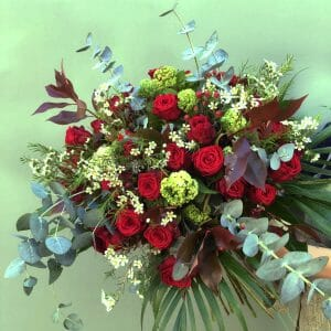 Photo showing a sample bouquet of a red rose bouquet 24 stems, available to order from Kensington flowers London