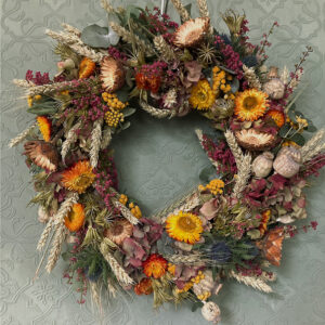 Photo showing a sample of an autumn wreath available to order from Kensington flowers London