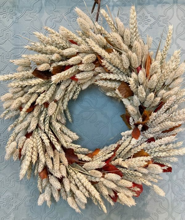 Photo showing a sample of an autumn door wreath available to order from Kensington flowers London