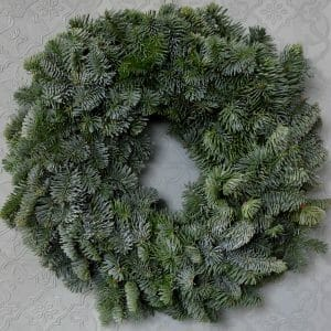 Photo showing a sample of a Plain Blue pine wreath ready to decorate from Kensington Flowers London