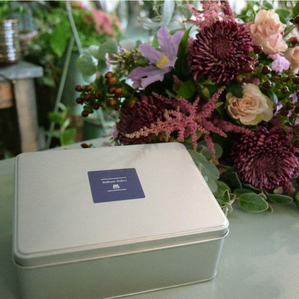 Photo showing a sample of a flowers and shortbread gift set, available to order with flowers from Kensington flowers London as part of a gift set