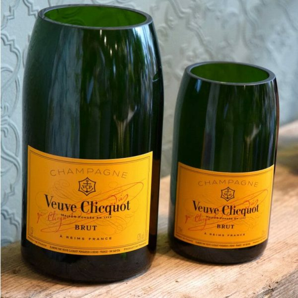 Photo showing a sample of the orange label Brut Champagne bottle vases available from Kensington flowers London. Bottles recycled and made into vases