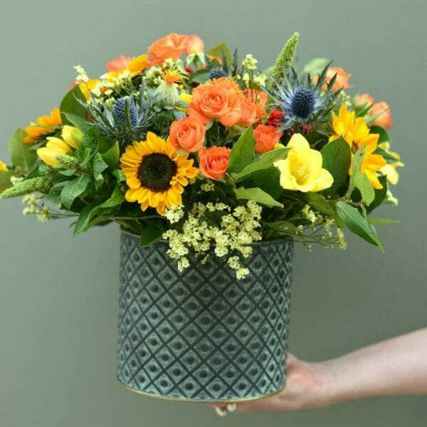 Photo showing a sample of a bucket of flowers, in mixed vivid colours available to order from Kensington flowers, London