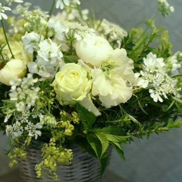 Photo showing a sample image of a bucket of flowers in white colours available to order from Kensington flowers, London