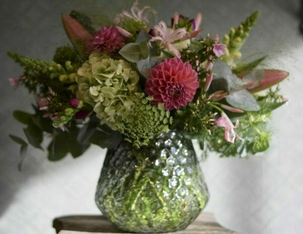 Photo showing a sample of a Studio choice vase arrangement, late summer nerines, hydrangeas and Dahlia pastel colours. Kensington flowers, London