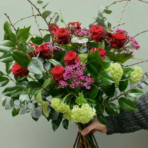 photo showing a sample of a classic red rose bouquet available to order from Kensington flowers London