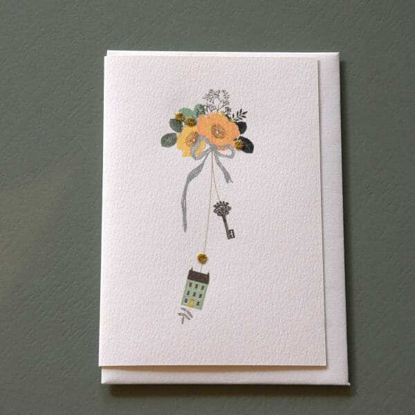 Photo showing a sample of an Elena Deshmukh new home gift card available to buy with flowers at Kensington flowers London