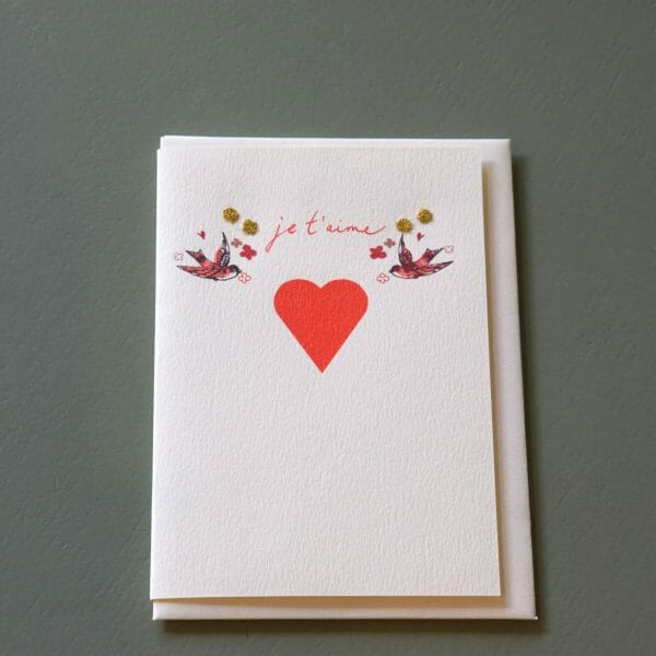"Photo showing a sample of an Elena Deshmukh love ""je t'aime gift card available to buy with flowers at Kensington flowers London"