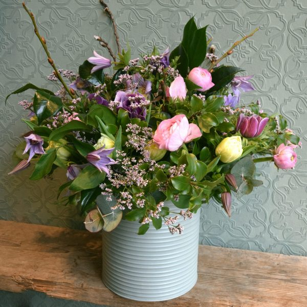 Photo showing a sample of a Flower tin bucket pastel shades available to order from Kensington flowers London
