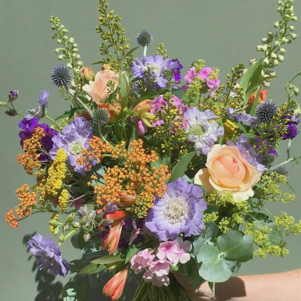 Photo showing a mix pastel Handful bunch of British flowers available from Kensington flowers London