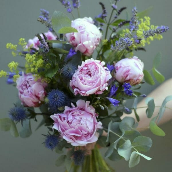 A photo showing a sample bouquet of a Handful flowers bunch of pink peony flowers available to order from Kensington flowers London