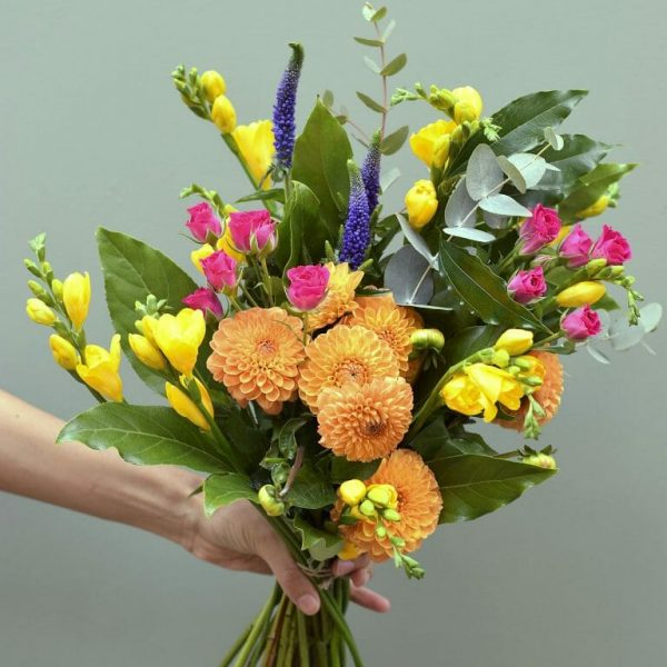 Photo showing a sample of A Handful bunch of flowers in mixed vivid colours available at Kensington flowers London