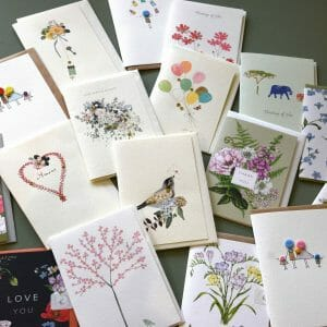 Photo showing a sample selection of handmade gift cards available to but with flowers