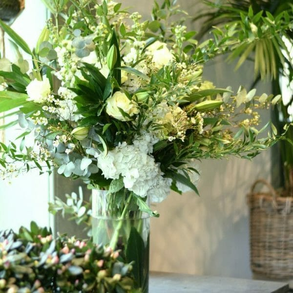 Photo showing a sample of a large Seasonal classic vase arrangement, available to order from Kensington Flowers London