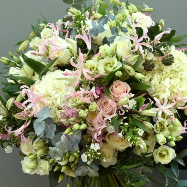 Photo showing a sample of a pastel Luxury seasonal rose bouquet available from Kensington Flowers London