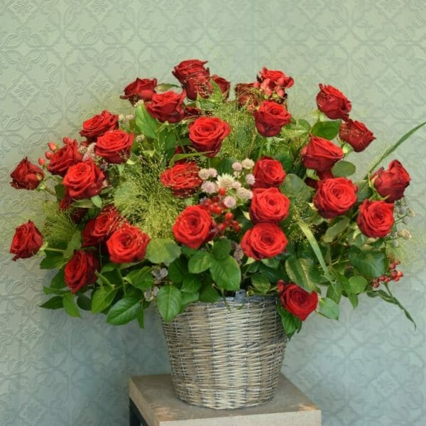 Photo showing a sample of a studio vase Red rose container arrangement available to order from Kensington flowers London