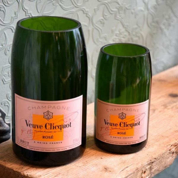 Photo showing a samples of Rose label Brut Champagne bottle vases available from Kensington flowers London. Bottles recycled and made into vases