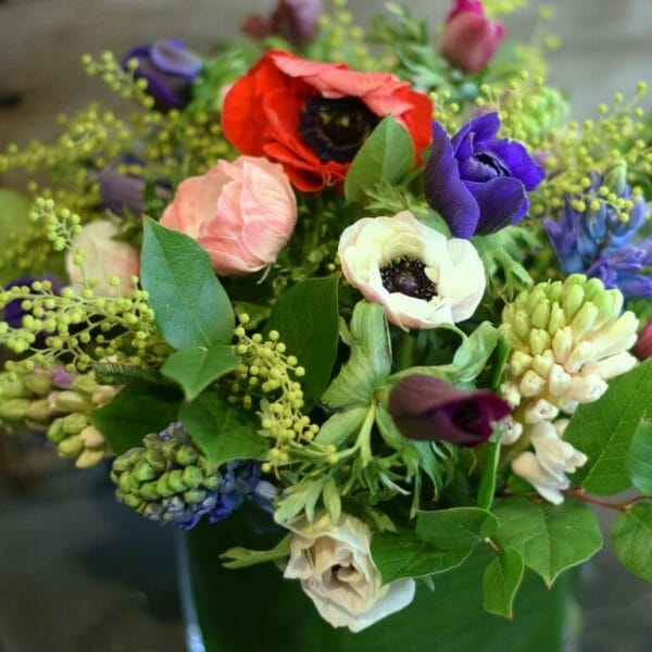 photo showing a sample of a Seasonal spring vase arrangement of mixed colours available from Kensington flowers, London