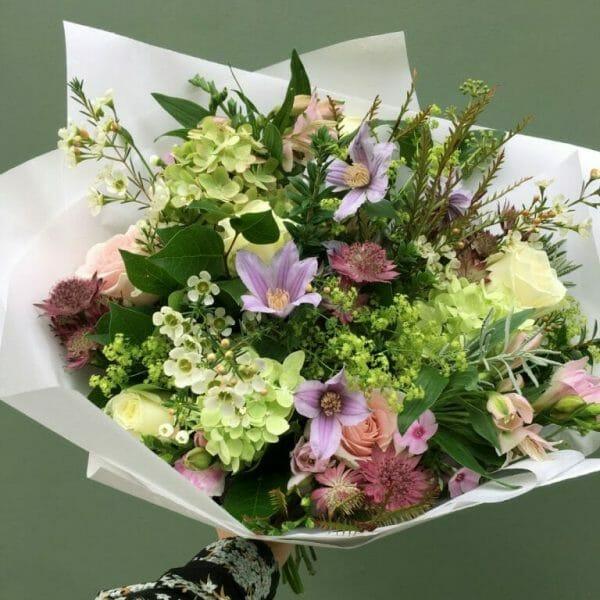 Photo showing a sample of a Seasonal handtied bouquet vivid Kensington Flowers London