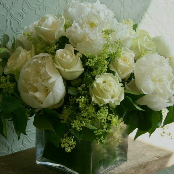 Photo showing a sample of a Studio florist choice Vase Arrangement - White peony and rose flowers - Kensington flowers, London