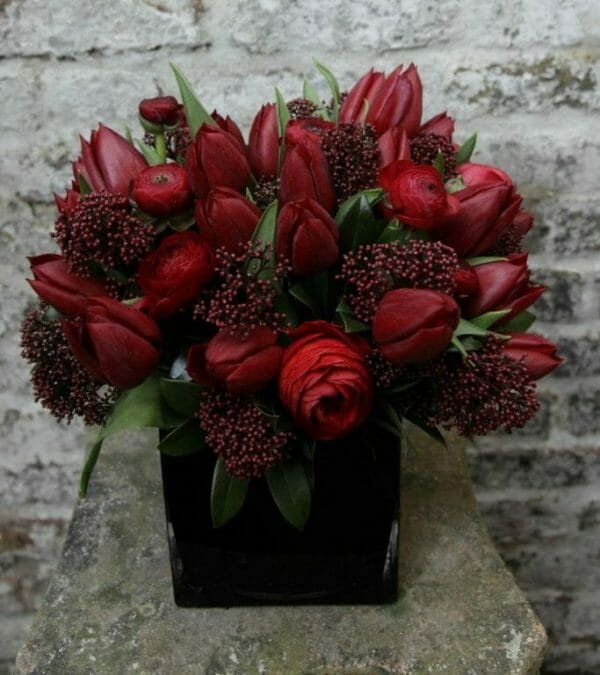 Photo showing a sample of a Studio Vase Arrangement - Red spring flowers - Kensington flowers, London