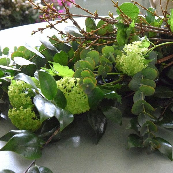 Photo showing a sample of a Florist choice foliage bundle as part of home subscription flowers, available from Kensington flowers London