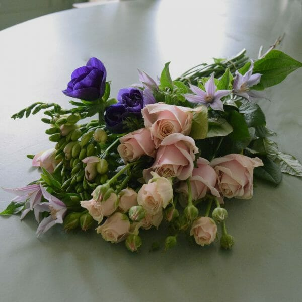Photo showing a sample of a Florist choice flower bundle as part of home subscription flowers, available from Kensington flowers London