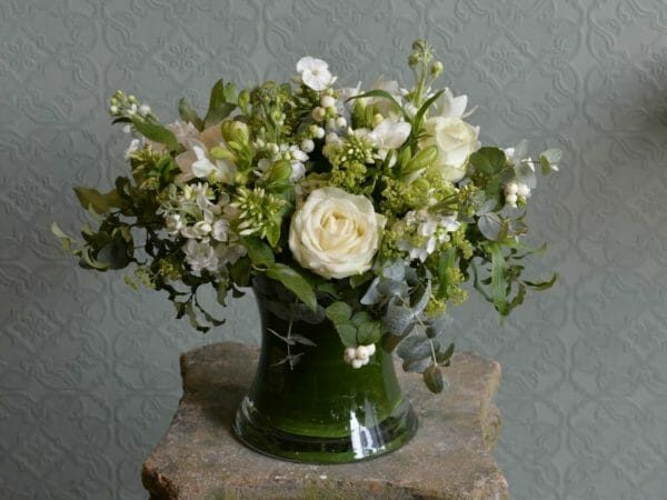 Photo showing a sample of a white Scented garden vase arrangement of Roses, freesia and stock vase arrangement from Kensington flowers
