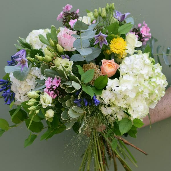 Photo showing a sample of a studio florist choice, mixed colour flower bouquet available from Kensington flowers London