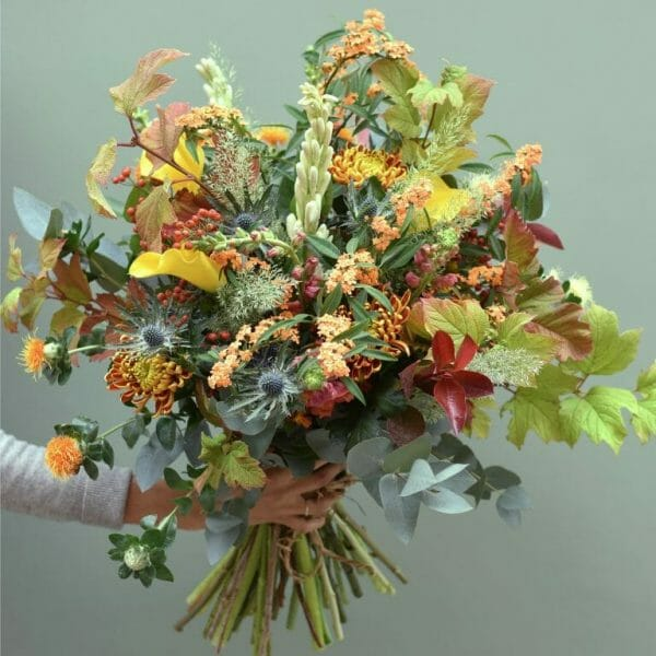 Photo showing a sample of a Seasonal hand tied bouquet Autumnal shades available from Kensington flowers London