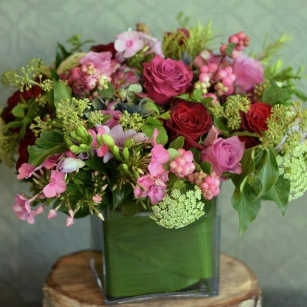 Photo showing a sample of seasonal rose vase arrangement mixed pink shade colours Kensington flowers. London