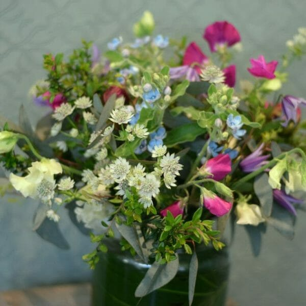Photo showing a sample of a Seasonal classic vase arrangement, Mixed colours, available to order from Kensington Flowers London