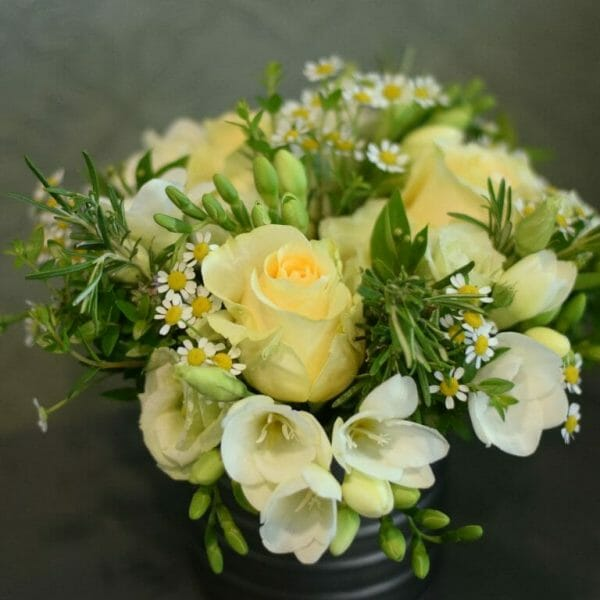 Photo showing a sample of a small bucket/tin of flower in yellow and white available to order from Kensington flowers London