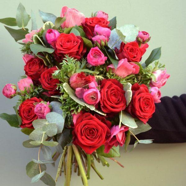 Photograph of a vivid seasonal rose bouquet available from Kensington Flowers London