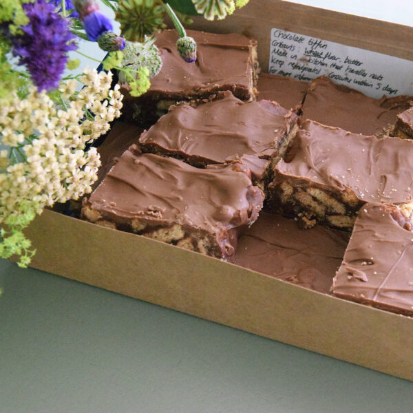Photo showing a sample of a flower and chocolate tiffin gift set available to order at Kensington Flowers London